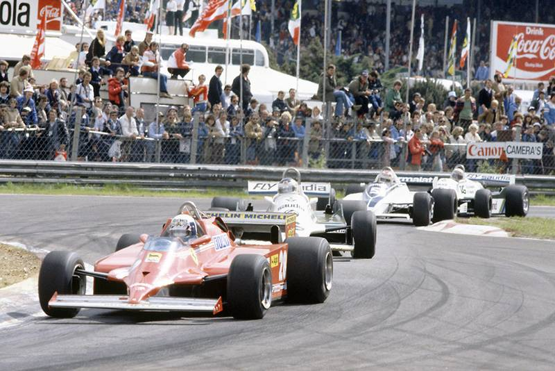 Didier Pironi (Ferrari 126C) leads Carlos Reutemann (Williams FW07C-Ford Cosworth), Nelson Piquet (Brabham BT49C-Ford Cosworth) and Alan Jones (Williams FW07C-Ford Cosworth).