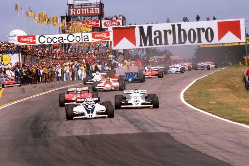 Nelson Piquet (Brabham BT49C Ford) leads Carlos Reutemann (Williams FW07C Ford) and Didier Pironi (Ferrari 126CK) at the start.