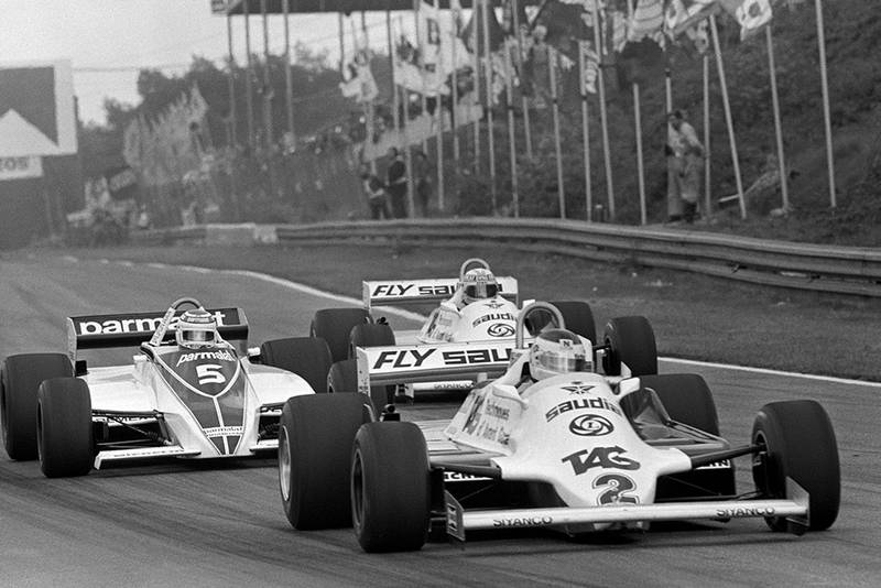 Carlos Reutemann in a Williams FW07C leads Nelson Piquet in his Brabham BT49C and Alan Jones in a Williams FW07C.