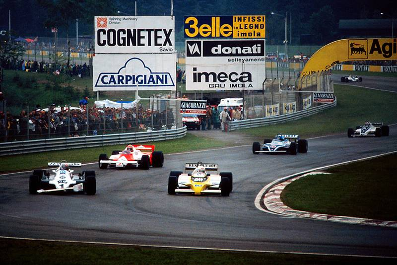 Alan Jones in a Williams FW07C (with a damaged front wing after contact with his team mate), is overtaken at Tosa by Rene Arnoux in his Renault RE20.