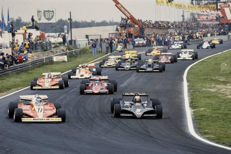 Mario Andretti (Lotus) and Carlos Reutemann (Ferrari) contest the lead into the first corner of the 1978 Belgian Grand Prix, Zolder.
