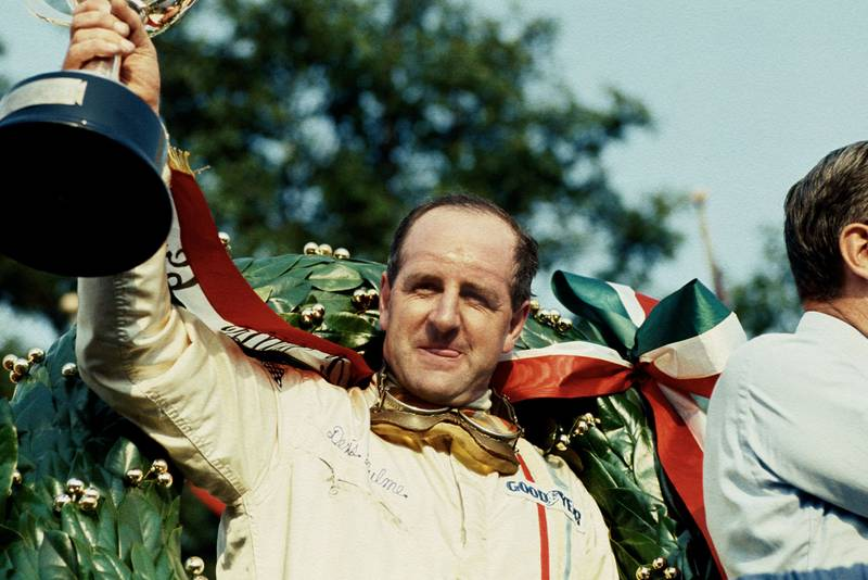 Denny Hulme (McLaren Ford) 1st position on the podium.