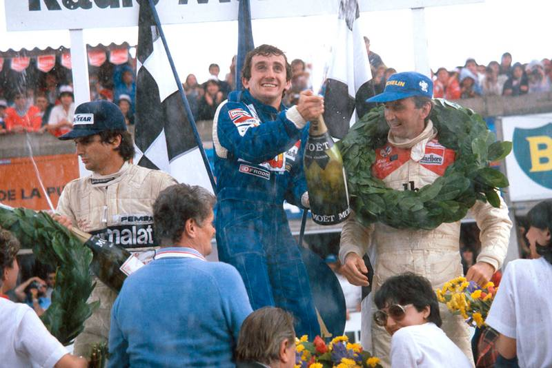 Winner Alain Prost, 2nd placed John Watson and Nelson Piquet in 3rd position on the podium.