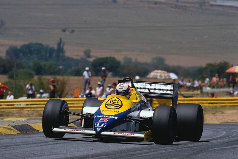 Nigel Mansell driving his Williams FW10 Honda in 1st position.