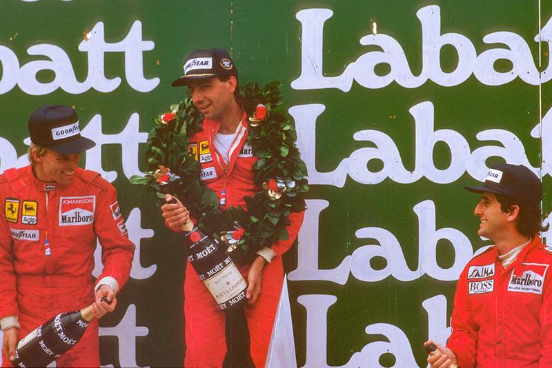 Michele Alboreto, 1st position, Stefan Johansson, 2nd position and Alain Prost, 3rd position, on the podium.