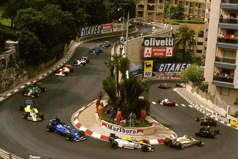 The cars make their way round the hairpin.