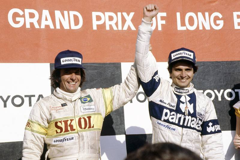 Nelson Piquet (Brabham BT49-Ford Cosworth), 1st position and Emerson Fittipaldi (Fittipaldi F7-Ford Cosworth), 3rd position on the podium.