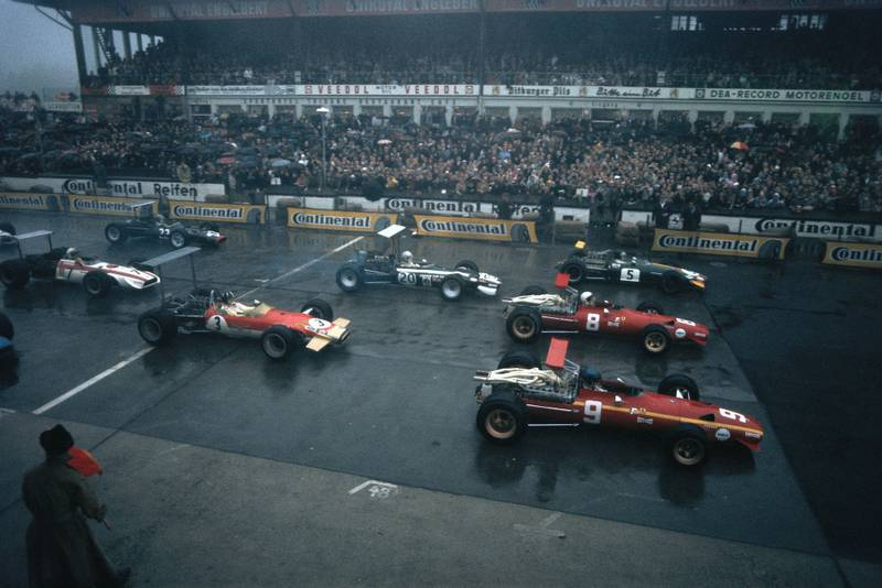 Jacky Ickx, Ferrari 312, leads the field away. Team mate Chris Amon, Jochen Rindt, Brabham BT26 Repco, Vic Elford, Cooper T86B BRM, and Graham Hill, Lotus 49B Ford, follow after.