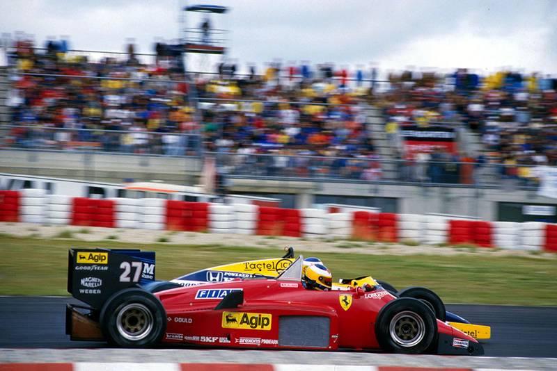Race winner Michele Alboreto (Ferrari 156/85) overtakes Keke Rosberg (Williams Honda FW10).