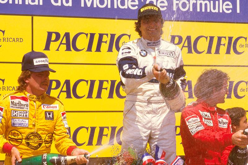 Nelson Piquet, 1st position, Keke Rosberg, 2nd position and Alain Prost, 3rd position on the podium.