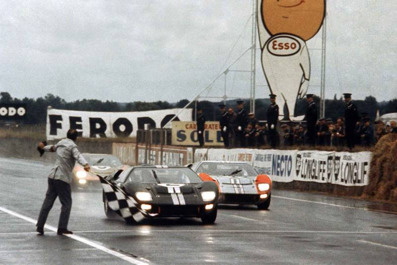 Bruce McLaren edges ahead of Ken Miles at the finish of the 1966 Le Mans 24 Hours, both in Ford GT40 MkII