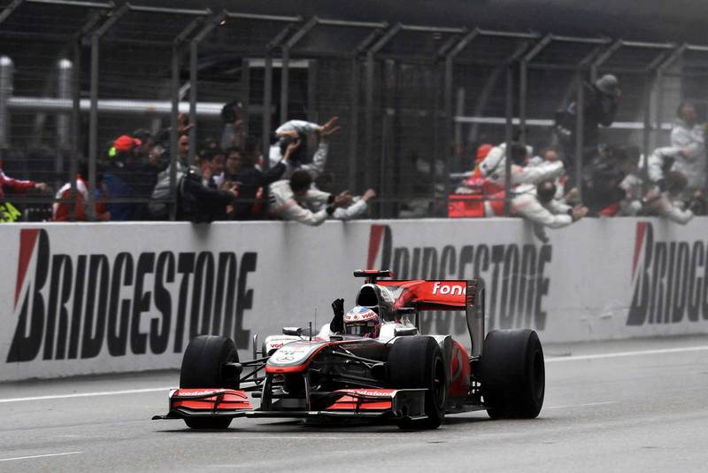 Jenson Button crosses the line for McLaren-Mercedes at 2010 Chinese Grand Prix Shanghai