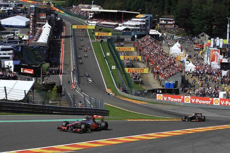 Jenson Button leads the field through Eau Rouge in his McLaren-Mercedes at 2012 Belgium Grand Prix Spa-Francorchamps