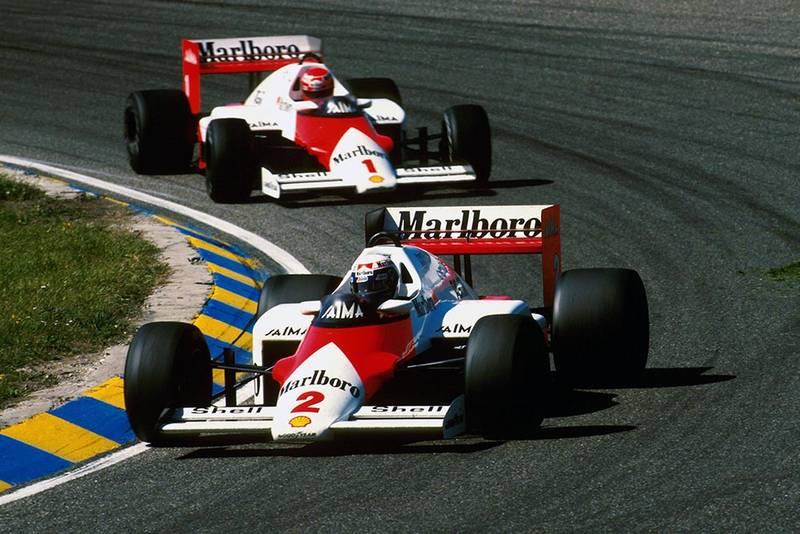 Alain Prost leads teammate Niki Lauda both in McLaren MP4/2B.