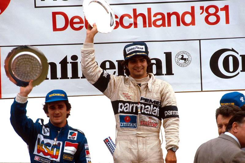 Nelson Piquet (Brabham Ford) 1st position and Alain Prost (Equipe Renault) 2nd position on the podium.