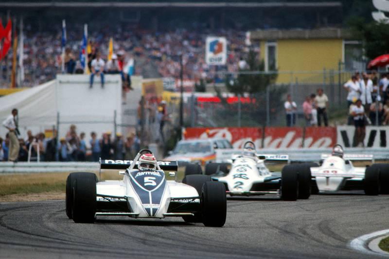 Race winner Nelson Piquet (Brabham BT49C), ahead of Carlos Reutemann (Williams FW07C).