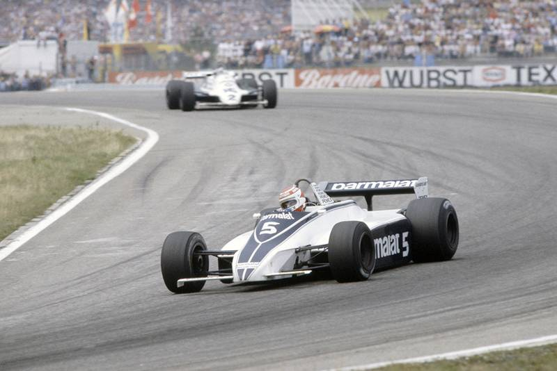 Nelson Piquet (Brabham BT49C-Ford Cosworth) leads Carlos Reutemann (Williams FW07C-Ford Cosworth).
