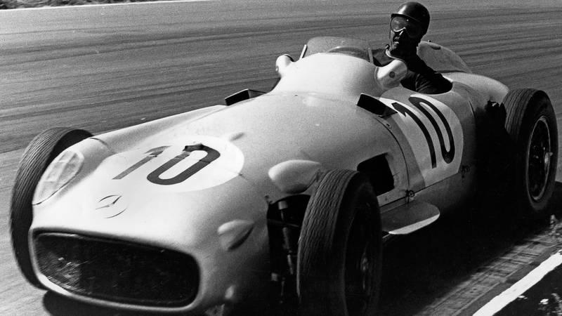 Juan Manuel Fangio cornering during the 1955 British Grand Prix at Aintree