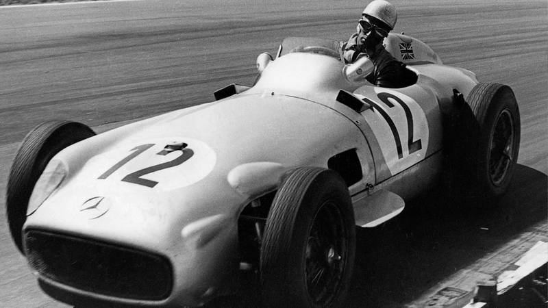 Stirling Moss during the 1955 British Grand Prix at Aintree
