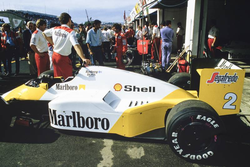 Keke Rosberg's yellow and white McLaren at the 1986 Portuguese Grand Prix