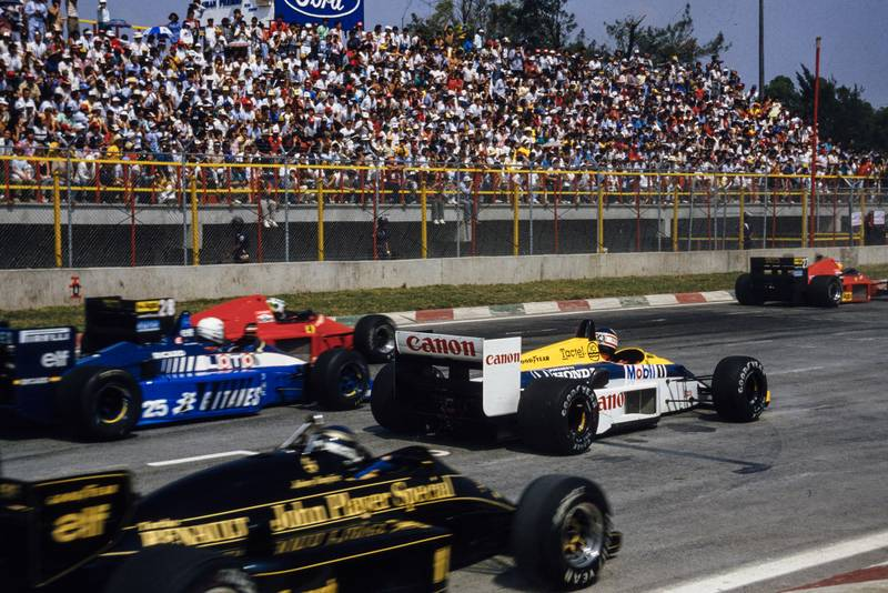 A slow-starting Nigel Mansell is passed by three cars on the grid at the 1986 Mexican Grand Prix