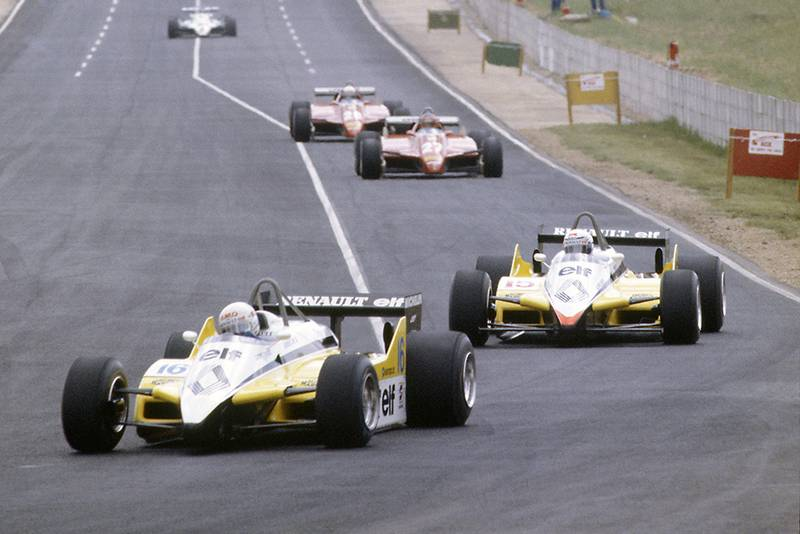Rene Arnoux leads Alain Prost (both Renault RE30B), Gilles Villeneuve and Didier Pironi (both Ferrari 126C2).