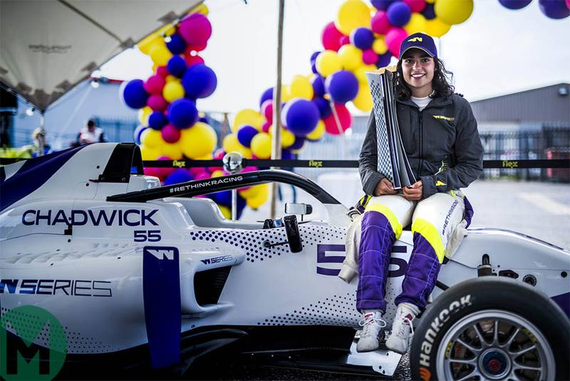 Jamie Chadwick holds the W Series championship trophy at Brands Hatch