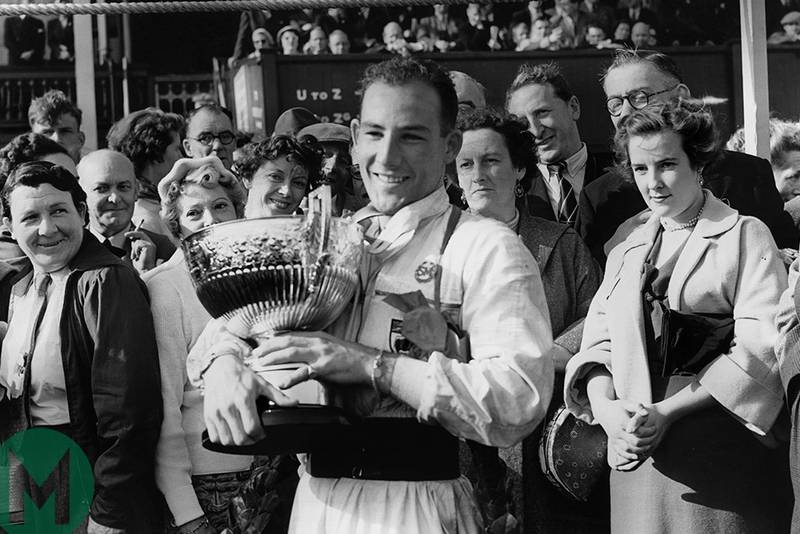 Sir Stirling Moss with the winning cup from the 1954 daily Telegraph Trophy at Aintree