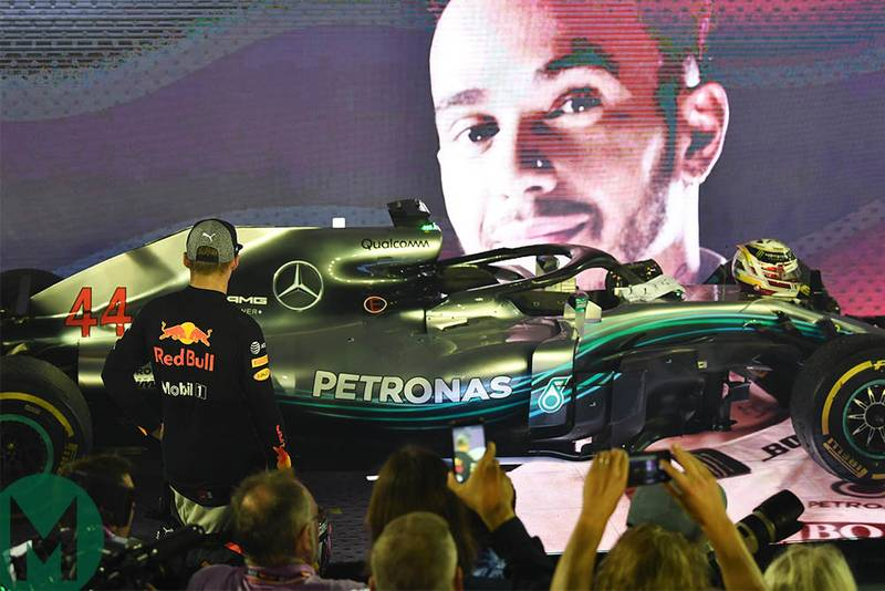 Max Verstappen looks at the Mercedes W09 in parc ferme at the 2018 Singapore Grand Prix