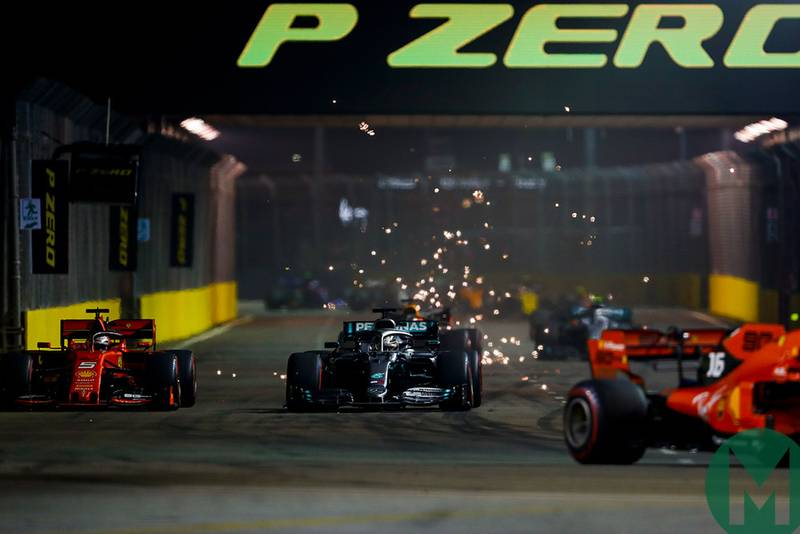 Sebastian Vettel attacks Lewis Hamilton for second place on the first lap of the 2019 F1 Singapore Grand Prix