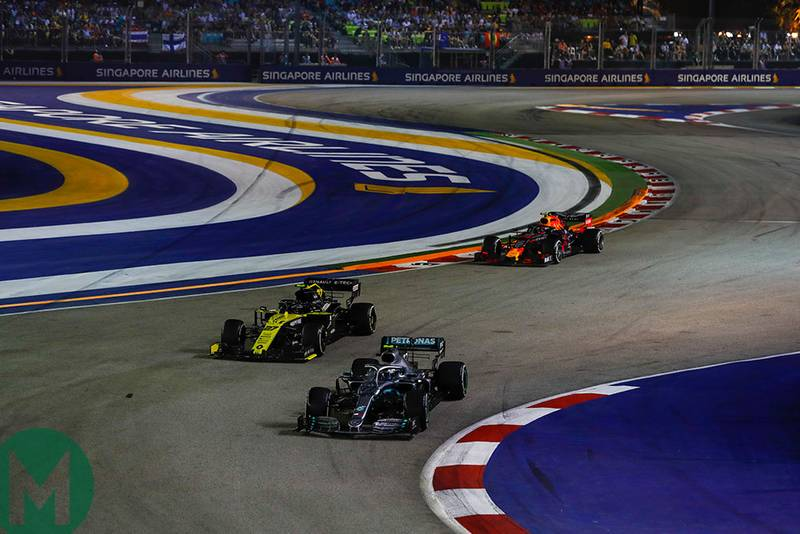 A slow-lapping Valtteri Bottas fends off Nico Hulkenberg and Alex Albon at the 2019 F1 Singapore Grand Prix