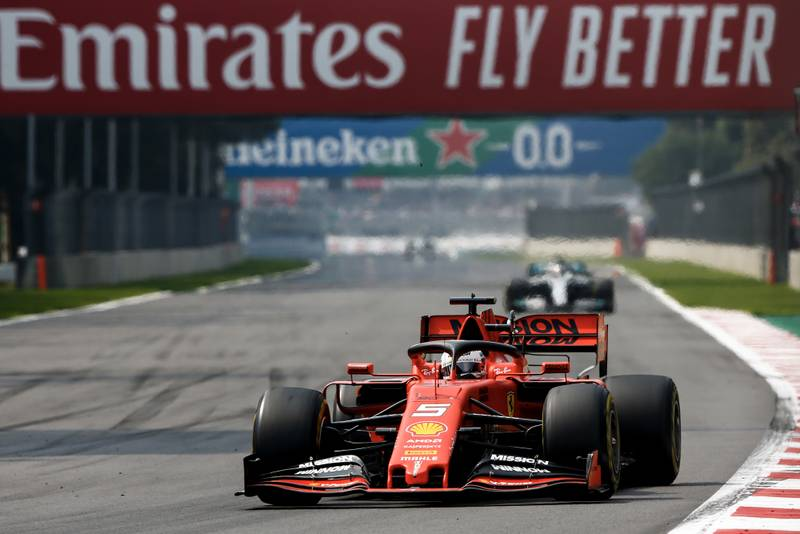 Sebastian Vettel leads Lewis Hamilton during the 2019 F1 Mexican Grand Prix