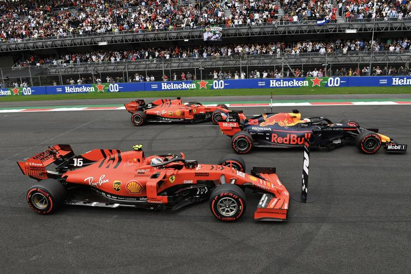 Max Verstappen parked in the pole-sitters position after qualifying for the 2019 F1 Mexican Grand Prix, flanked by two Ferraris