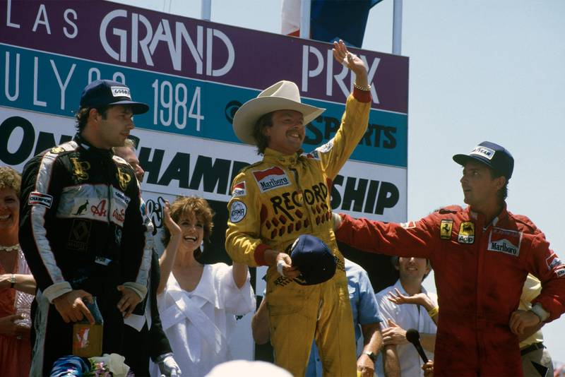 Keke Rosberg stands atop the podium after winning the 1984 Dallas Grand Prix