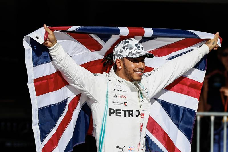 Lewis Hamilton celebrates winning his sixth drivers' championship title