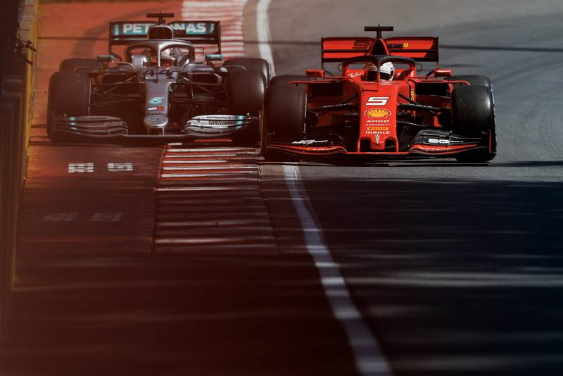Sebastian Vettel squeezes Lewis Hamilton against the wall during the 2019 Canadian Grand Prix