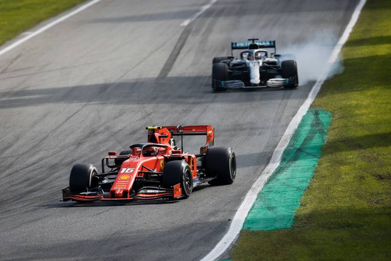 Lewis Hamilton locks up in pursuit of Charles Leclerc during the 2019 Italian Grand Prix