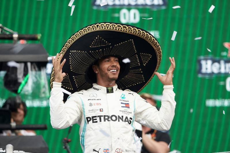 Lewis Hamilton celebrates in his sombrero after winning the 2019 Mexican Grand Prix