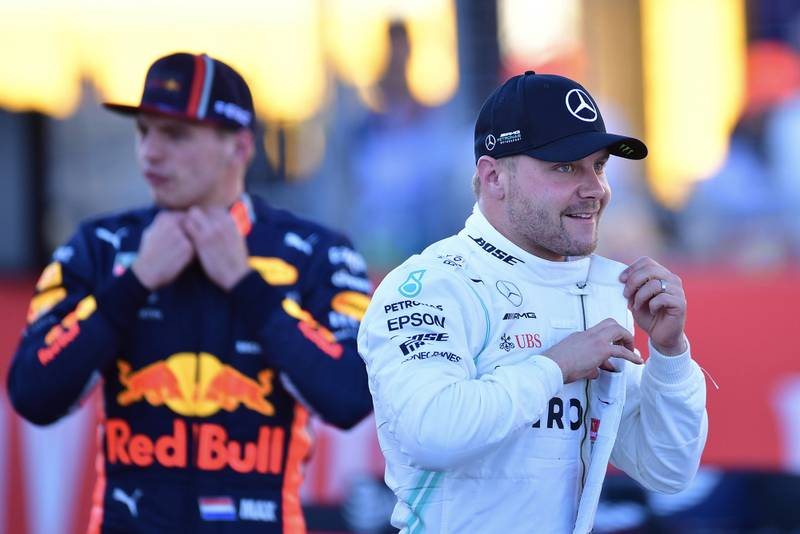 Valtteri Bottas with Max VErstappen in the background after qualifying for the 2019 US Grand Prix