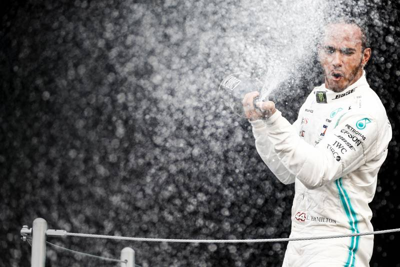 Race-winner Lewis Hamilton spraying champagne on the podium at the 2019 Mexican Grand Prix