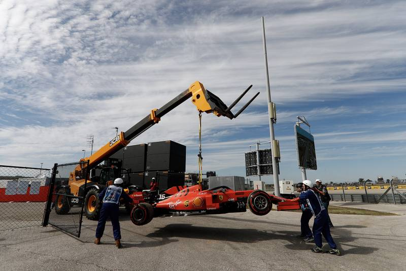 Charles Leclerc's car is lifted away from the circuit at the 2019 United States Grand Prix after suffering an oil leak during practice