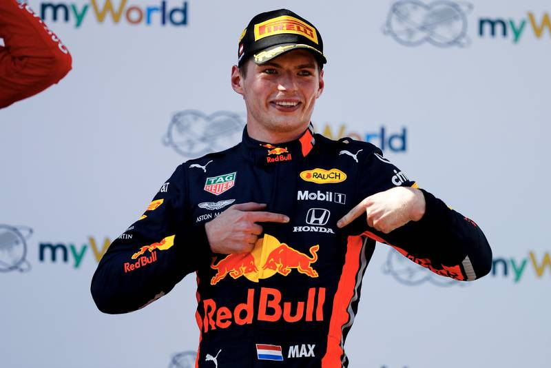 Max Verstappen points at his Honda badge after winning the 2019 Austrian Grand Prix