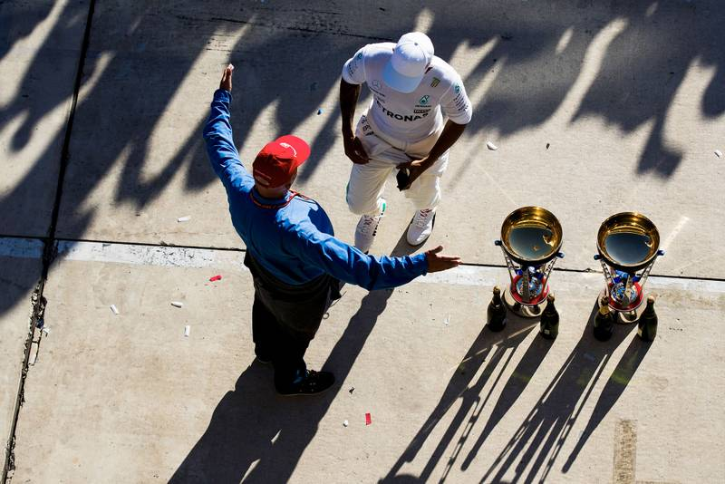 Overhead shot of Niki Lauda holding his arms wide as Lewis Hamilton walks up after the 2017 US Grand Prix
