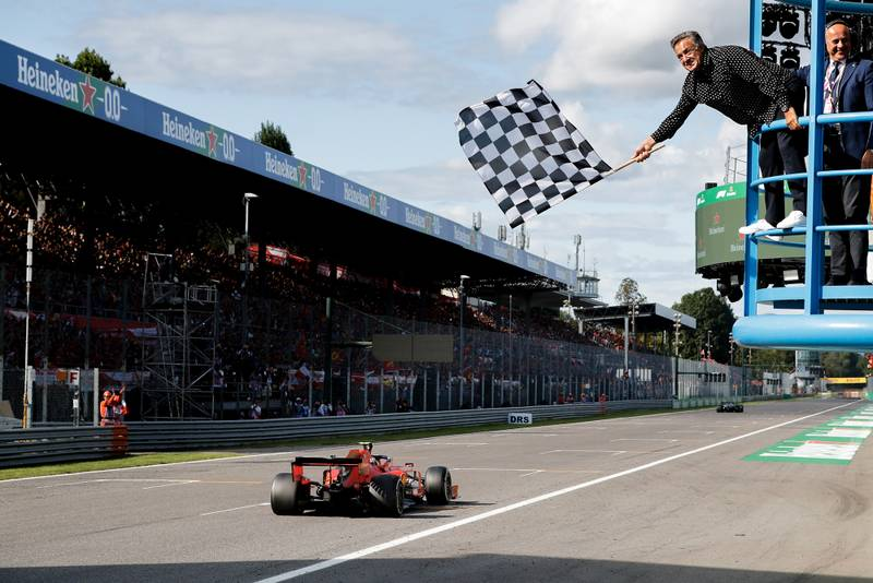 Jean Alesi waves the chequered flag at the 2019 Italian Grand Prix