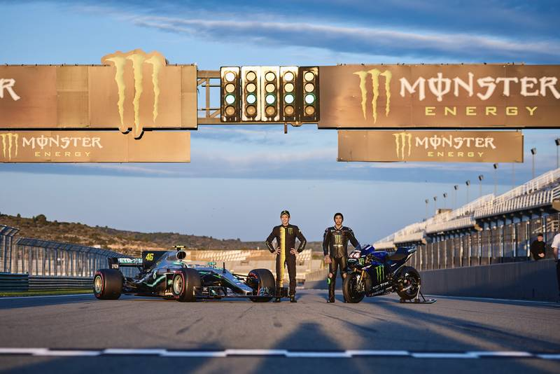 Lewis Hamilton and Valentino Rossi pose in front of the 2019 Yamaha M1 and 2017 Mercedes W08