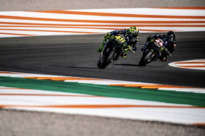 Lewis Hamilton and Valentino Rossi ride side by side on Yamaha MotoGP bikes