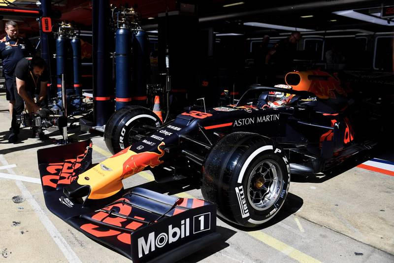 Max Verstappen pulls out of the Red Bull pit garage