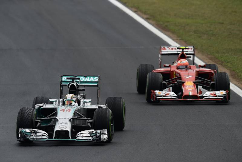 Lewis Hamilton ahead of Kimi Raikkonen's Ferrari in the 2014 F1 season