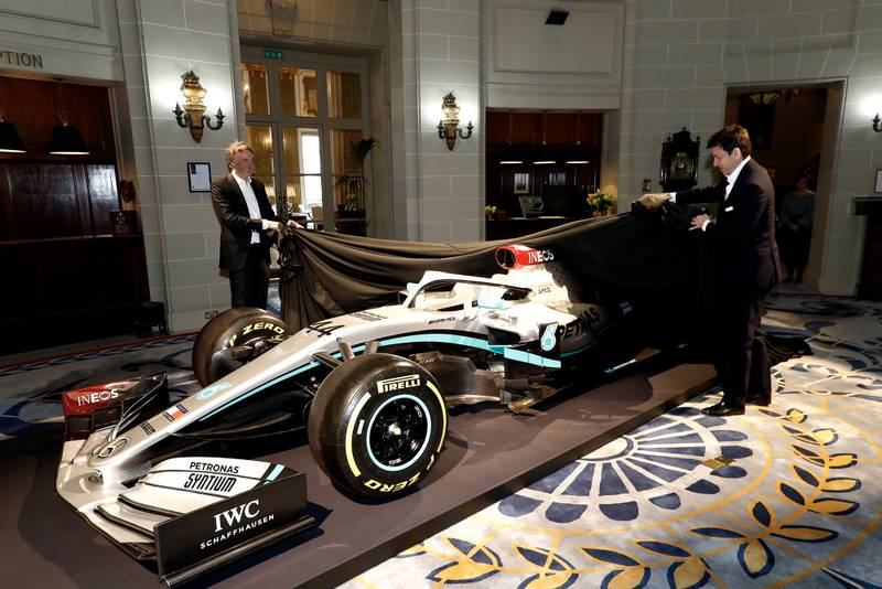 Toto Wolff and Sir Jim Ratcliffe take the covers off a car with Mercedes 2020 livery at the Royal Automobile Club