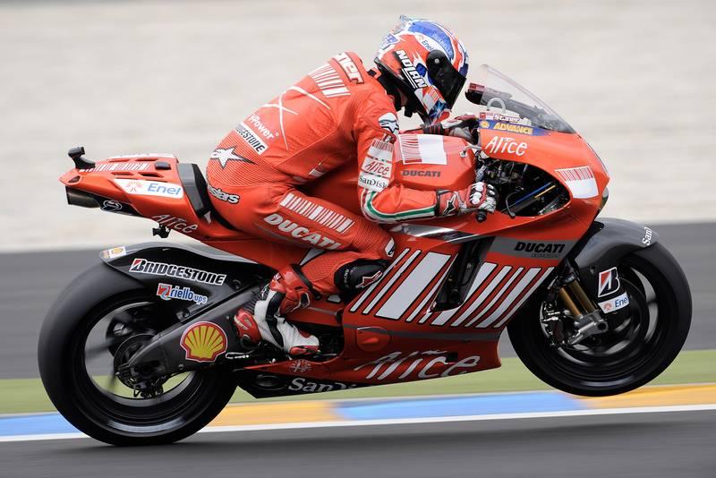 Casey Stoner lifts a front wheel of his Ducati Desmosedici